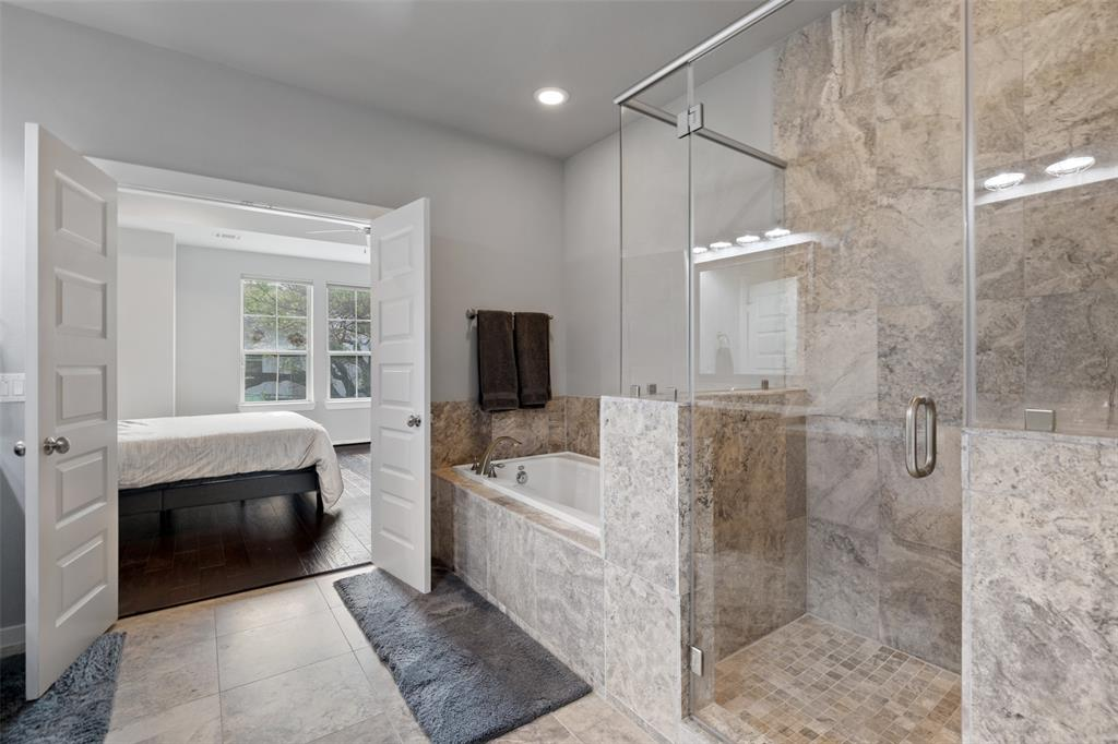 The primary bath also features a separate tub and shower.