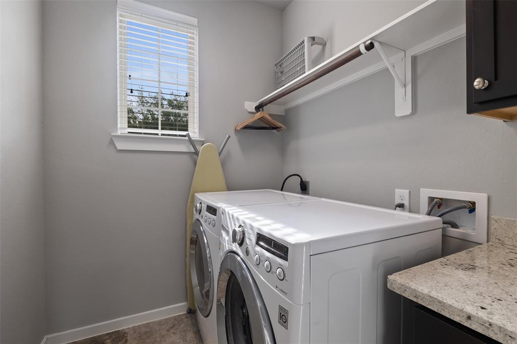 The utility room on the third floor has additional storage and the washer and dryer are included.