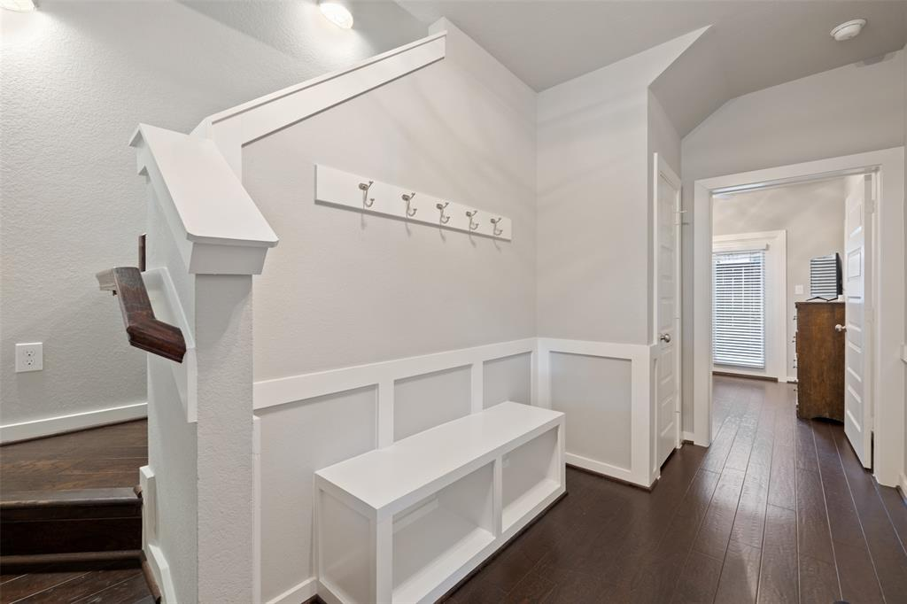 The inviting entry features built-in storage.