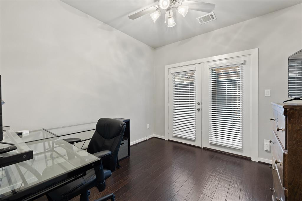 Bedroom # 2 features wood floors, neutral colors and access to the back outdoor space.