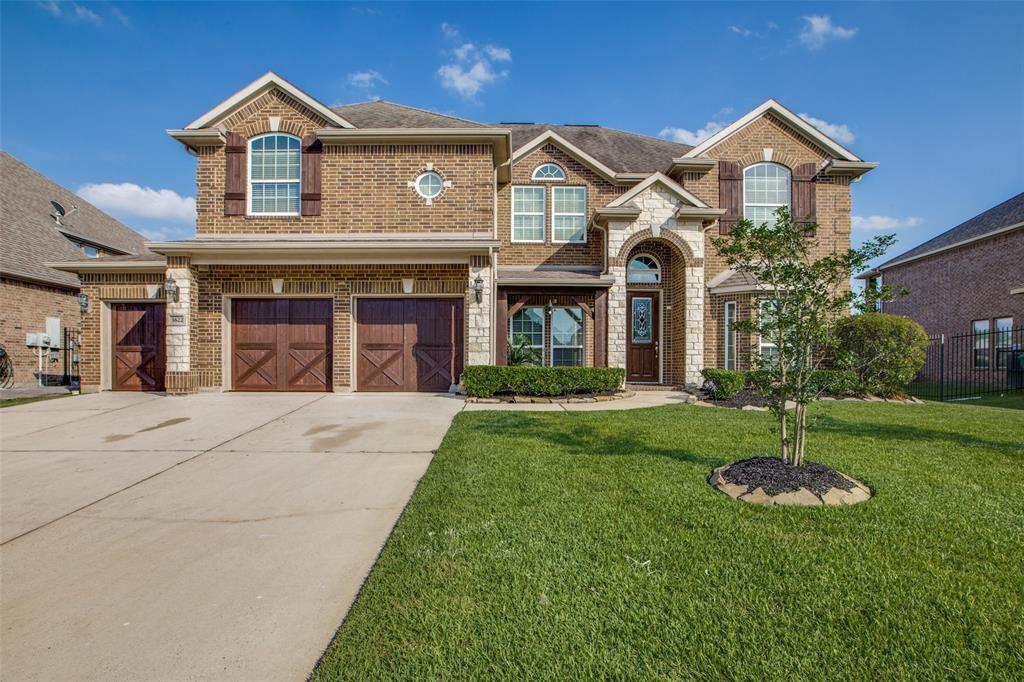 Welcome home to custom luxury on premium green belt (no back neighbors) in gorgeous, safe Harmony community w/ swimming pool, splash pad, park & tennis/basketball courts w/in 24-hour manned gate entry.   99/Hardy/ I-45 access, shopping, movie theater, restaurants, urgent care, & CISD schools 5 minutes away; Middle/Jr High 5min walk.  Your home boasts many custom touches; wood floors throughout, cabinetry, spiral stair case w/ Juliet balcony, butler's pantry, wine grotto, security system, 9 zone sprinkler system, and 3-car epoxy finish garage w/ insulated wood doors. 1st floor w/ two living & dining areas + office/optional in-law suite and walk-in shower down. Kitchen opens to family room w/ 20' vaulted ceilings & floor to ceiling stone fire place. 1st floor master w/jetted tub & is downstairs and has a 12X14closet and optional mother-in-law suite w/ walk-in shower located downstairs. 2nd floor 2BR w/Jack and Jill and 2Br w/hall bath, pre-wired media room w/closet storage and game room.