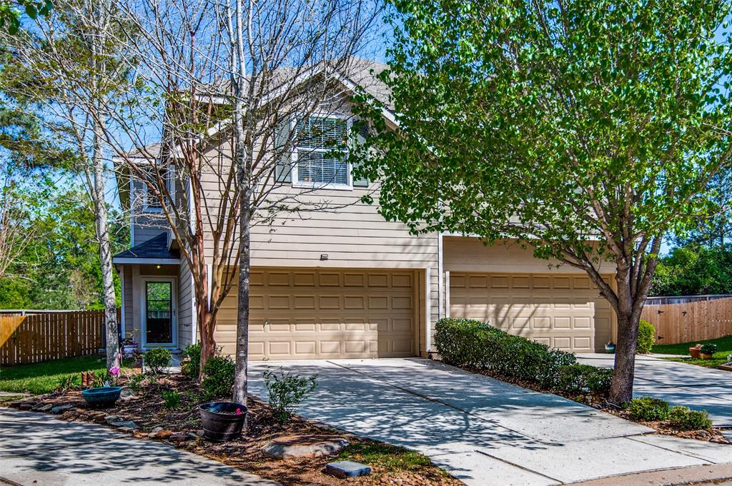 """LOCATION! LOCATION! LOCATION! Located on a cul-de-sac lot, in The Woodlands, just minutes from I-45, Hwy 242, and FM 1488! This 3 bedroom 2 1/2 bath townhome features a light, bright and functional open floor plan. Huge master retreat with spacious secondary bedrooms that offer walk-in closets. Loft area upstairs makes for a perfect office space, children's retreat, or movie/reading nook. Meticulously maintained, this townhome is BETTER THAN NEW! Updates include beautiful warm wood floors, granite countertops, 42"""" cabinets, stainless steel appliances, walk-in pantry, fresh paint throughout, new carpet in carpeted areas, ceiling fans, and recent 16 Seer Trane HVAC system for energy efficiency and lower utility bills! Privacy is not a problem with NO REAR NEIGHBORS and a spacious fully-fenced back yard.  The back yard also features a large deck that is perfect for a grill, table, and chairs! Stainless steel refrigerator, washer, and dryer are INCLUDED! Available for immediate move-in."""