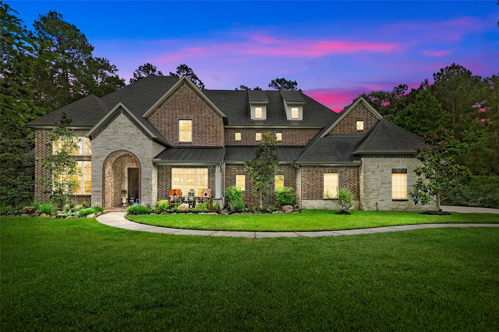 Stunning custom on 11th hole of High Meadow Ranch Golf Club, just seconds from the clubhouse, nestled on a beautifully wooded 1.62 acres with a quartet of magnolia trees. This home will feature a very livable & inviting floorplan that greets you with handsome double doors opening to the foyer that gives a direct sightline of the dramatic winding staircase with accented custom lighting. Framed columns and exposed beams reveal a chef's kitchen featuring a 5 burner stove, double ovens, oversized bar, island w/storage, and large walk-in pantry. Entertain guests in the formal dining with hand-painted ceilings, and upscale lighting. All bedrooms have ensuite baths and expansive closets. Elegant primary suite w/separate door to back patio and a handmade original barndoor that makes way into the exquisite primary bath boasting his & her closets, pass-through separate shower & soaking tub. Upstairs gameroom flows into additional flex room. Picturesque bricked patio overlooking a wooded retreat.