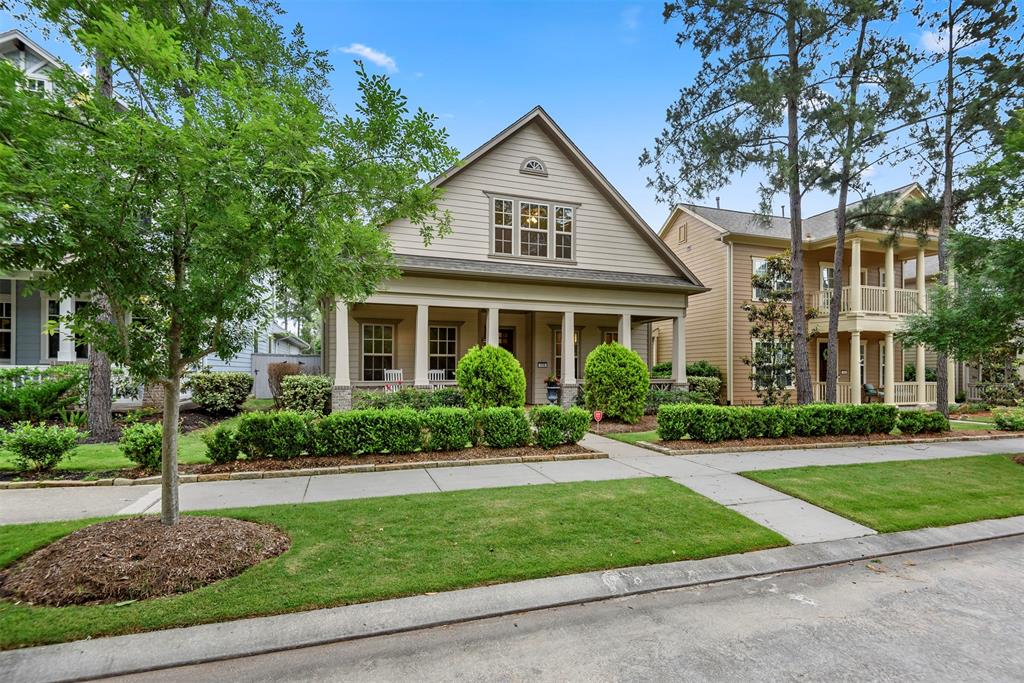 Adorable CRAFTSMAN style cottage w/Large front porch located on a QUAINT BLVD in highly sought after LIBERTY BRANCH.Walk to all that CREEKSIDE has to offer including the Town Center HEB & restaurants. Enter into the OPEN CONCEPT floor plan with beautiful HARDWOODS & high ceilings, A GOURMET ISLAND KIT w/THERMADOR appliances including a full size GAS RANGE plus a built in wall convection oven. The large FAMILY features a gas log FIREPLACE & wall of windows overlooking the BACKYARD OASIS. The banquet sized formal DINING is open to the kitchen & family making this a GREAT HOME FOR ENTERTAINING .MASTER is located DOWN w/high ceilings & executive bath w/ huge walk in closet. Upstairs there is a large GAME RM w/ BUILT-IN WET BAR w/beverage REFRIGERATOR +2 LARGE BEDS  & BATH. The BACKYARD features a large COVERED PATIO w/ SUMMER KITCHEN &beautifully landscaped yard w/ FOUNTAIN and room to add a future pool.  A DETACHED GARAGE is tucked behind & accessed through an ALLEY w/ ample parking.