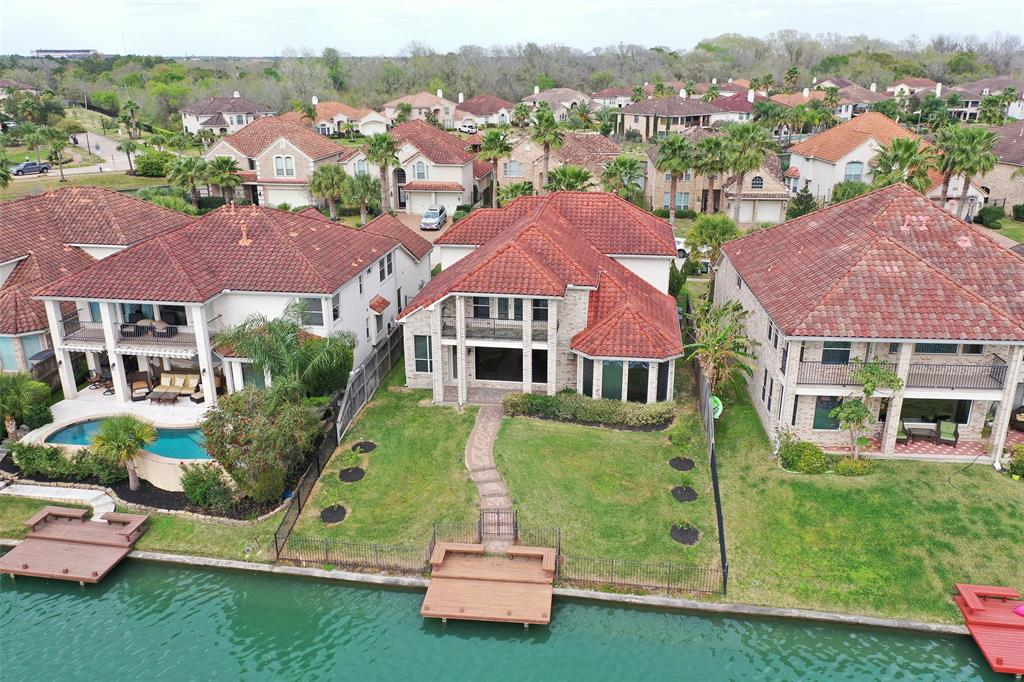 Come home every day to your very own resort style living community of Windsor Park Lakes! It just doesn't get better than this..excellent West Houston location, exceptional Katy ISD schools, & lakefront living loaded w/ amenities incl. manned gated access. Built in '08, the home is filled w/ luxury finishes & ready for move in! Views of the lake greet you from the minute you walk in & can be enjoyed from most rooms. The family room has a large picture window to the lake & your very own dock w/ benches to enjoy Texas sunsets. Fishing & boating are allowed. The downstairs master BR has bay windows w/ the same gorgeous views. Upstairs is a large game room w/ builtin speakers for surround sound & opens to a great balcony. 3 upstairs bedrooms w/ 3 full baths. The community has a Mediterranean style w/ tiled roofs, pave stone walkways/driveways. Amenities include swimming pool, gym, tennis courts, basketball court...a staycation every day! Do not miss your opportunity to call this your home!