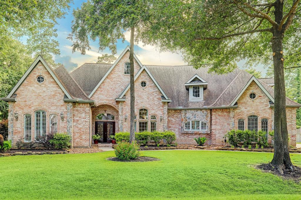 Located in a private enclave in Spring TX, this extraordinary 1.5 story custom home features 4 bedrooms, 3 full baths, and 2 half baths in the main house. Additionally the guest house comprises a kitchen, living area, and bed/bath along with a pool bath and outdoor shower. The main-floor owner's retreat has two 2 walk-in closets, separate vanities, and a cozy sitting area with a fireplace. Working from home is a joy in the huge study with built-in bookshelves and view to the sparkling pool. In the kitchen there's a gas cooktop, island, custom cabinetry, walk-in pantry, dry bar, and breakfast bar. The utility room is a dream come true with mud room storage, laundry, utility sink, and more. Upstairs you find the game/media/flex room to fit your lifestyle. Go outdoors to the expansive covered patio, pool with water features with a pergola backdrop. There is plenty of room to play with 28,000+ sf lot. Three car garage with motor court for parking. No MUD taxes. Klein ISD. Call to see it!