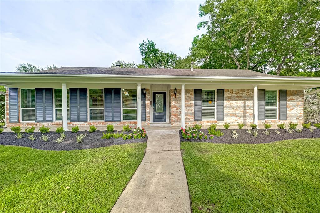 Light and bright charming one story home on an oversized (12,350 sq. ft!) corner lot-walking distance to Rummel Creek Elem. Kitchen is open to the family room and has a center island for prep work, double ovens, gas cooktop, abundant counter space & cabinetry. Primary bedroom has 2 closets and ensuite bath with 2 vanities.  Guest bath features double sinks and charming claw foot tub. Updates include tankless water heater and low-e windows. Half bath added with easy access to poolside entertaining. Backyard is a showstopper! Large patio, lots of green space and beautiful pool/huge spa are set back on the lot. Newer pool heater! Home is walking distance to City Centre. Zoned to Rummel Creek/Memorial Middle/Stratford.