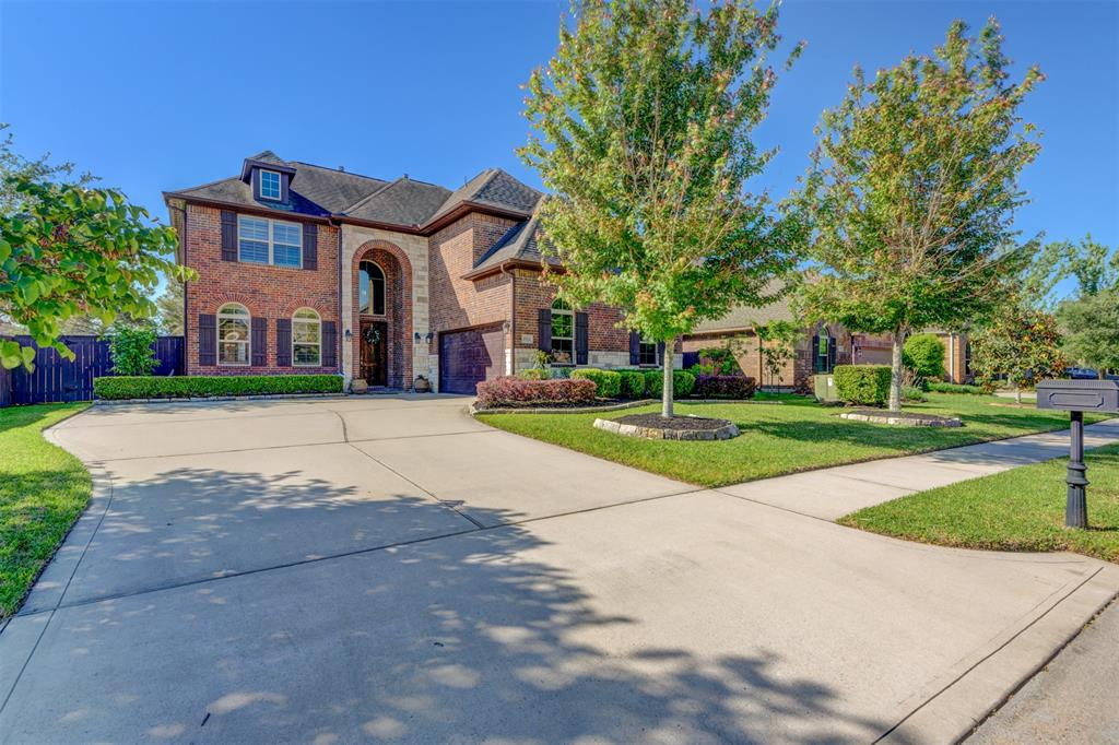 Beautiful, well-maintained 5-bed/4 full-bath home with lake view nestled in Lakes of Cypress Forest, a gated community. Extra-wide driveway connects to two-car garage w/ epoxy flooring and custom cabinetry. Inviting entryway leads into 20-ft-high foyer w/ tasteful art niches. Grand family room has 16ft-high ceiling, stone fireplace, rich wood flooring & large two-level windows that let ample sunlight through. Island kitchen comes w/ granite countertops, stainless steel appliances, and large pantry.  Guest bedroom with wood flooring on first floor can also be converted into study. Spacious master bedroom has beautiful view of the lake!  Huge media room upstairs, along with three bedrooms, game room & cozy loft/home office with balcony overlooking the lake. Large backyard has plenty of space for future pool. HOME NEVER FLOODED! Family-friendly community offers abundant walking trails around several lakes and a neighborhood playground/pool. Electric car friendly w/ 240v outlet in garage.