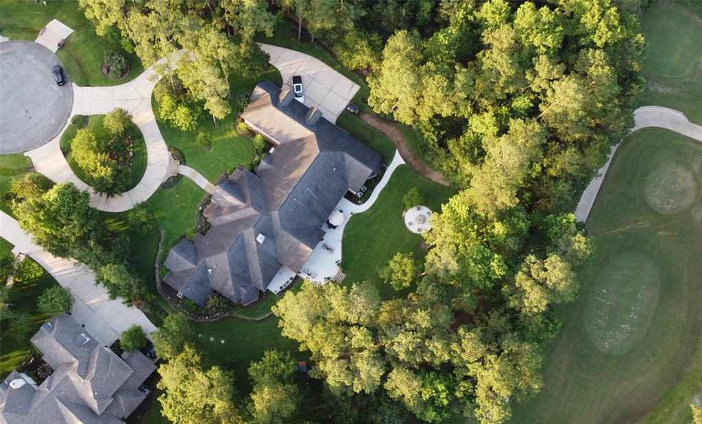 """Beauty & nature abound in this Stunning 5,593sf 4B/4.5B Custom built home! It sits on Tee Box 1 of High Meadow Golf Course & includes lot 10 for 2.82 acres on the cul-de-sac. Soaring ceilings, exposed beams & lovely wood & tile floors throughout. The inviting family room has ceiling to floor windows, custom built-ins & secret storage. It opens to a gourmet kitchen w/2 islands, granite counters, SS appliances, double ovens, gas cooktop w/griddle, """"Sonic"""" ice maker & more! The primary retreat offers trey ceilings, sitting area w/private entrance outside, ensuite w/kitchenette, flex room, massive walk-in shower, his/hers closets, jetted tub & separate vanities. A separate corridor has 3 add'l bedrooms w/ensuites & entrance to 1000sf flex space upstairs that's pre-plumbed & ready for buildout. Formal dining, massive study, media room, wine room, 4 car garage, whole home generator & vacuum, water softener/purification, Pex plumbing, huge laundry room & so much more! Magnolia ISD & low tax!"""