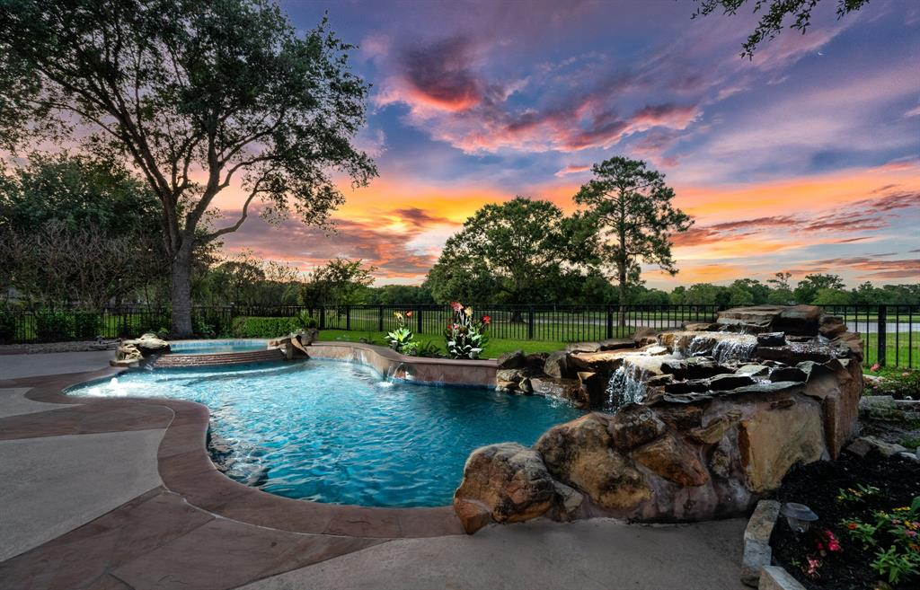 """Come discover this quintessential semi-custom """"Staycation"""" home nestled in the exclusive gated section of Blackhorse Ranch where resort style living collides with everyday life!You are greeted by the timeless & unmatched 2 story custom iron & glass door...Now that's a statement!The open & flowing floorplan w/stone archways guides your path of exploration.Abundant crown molding, high ceilings, natural light & luxury finishes. The Epicurean island kitchen w/upgraded gleaming luxury granite,stainless steel appliances,abundant 42"""" mahogany cabinets, designer light fixtures thru-out. And then there are the astoundingly stunning lake views of the golf course that will leave you breathless everyday!The """"resort style"""" pool oasis w/an expansive covered patio & outdoor kitchen brings outdoor living to another level!It even has an outdoor theater!Oversized primary suite w/firplace & completly remodeled en suite.Upstairs media experience,game room & excercise flex room(study?)w/stunning lake views"""
