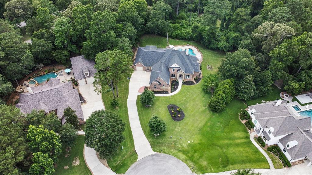 LOCATION, LOCATION, LOCATION! This beautiful 4-5 bedroom, 4 full and 2 half bath 3 car garage home is nestled on OVER 1.3 acres in a private cul-de-sac with quick access to the Grand Parkway. This hidden gem, is perfect for the multigenerational family. Sellers added over 1500 square feet in 2015. This gorgeous traditional style home features TWO master suites down-stairs, a Texas Sized Laundry room, and an enormous office perfect for working for home and or running a small business. Step outside into your back yard oasis with a covered patio, sparkling pool, with gorgeous lush and mature trees. Enjoy the fresh paint, Brand New Roof (2021), Water heaters (2019) home is equipped with a water softener system, mosquito misting system and surround sound in and outside of the home! You need to see this in gem in person!! Schedule your showing today! You don't want to miss this one!