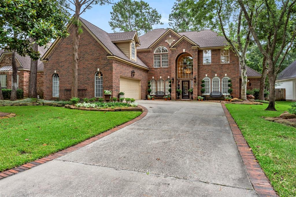 Custom home in sought after Cochrans Crossing. As you enter you have a lovely study with custom built ins and wood panelling. The formal dining room overlooks the formal living room with plantation shutters and real hardwood floors. The kitchen is open to the family room and breakfast room. The kitchen has stainless appliances and subzero fridge. Off the kitchen there is a built in desk area and large utility room. The two story windows in family room brings in tons of natural light with built ins and a double sided fireplace. There is a full bathroom downstairs. The master bedroom and updated bathroom are also on the first floor. Upstairs you have a game room with built ins and three spacious bedrooms. Don't miss the walk out attic over garage, its huge with air conditioning or heating!!  The yard has room for a pool and is lovely and private. Crown molding throughout the entire home is exquisite! Central location makes for easy access to anywhere in the woodlands.
