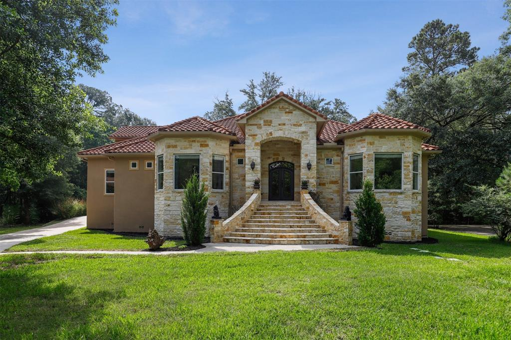Gorgeous custom-built Mediterranean home on a beautiful 1.5-acre private lot located in a gated community. Inside, you are welcomed by the grand double doors, & formal entry w/ a chandelier & travertine tile floors. The spacious living area features hardwood flooring, high ceilings, a large stone fireplace w/ built-ins & a wet bar perfect for entertaining. Adjacent, the open kitchen area includes professional-grade appliances w/ an industrial size fridge & steam oven, granite counters, ample cabinet storage, & a built-in desk. The HUGE primary suite features a 120'' screen w/ 4K projector, & an en-suite bath w/ 2 vanities, soaking tub, steam shower & large walk-in closet. This home also features 2 secondary bedrooms w/ a full bath at the front of the home & 2 addtl. bedrooms behind the kitchen w/ an infrared sauna & a full bath. Lastly, there are 2 bedrooms, 2 full baths In-Law suite/Nanny living quarters w/ separate entrances for maximum privacy.**SEE UPGRADE LIST IN ATTACHMENTS**