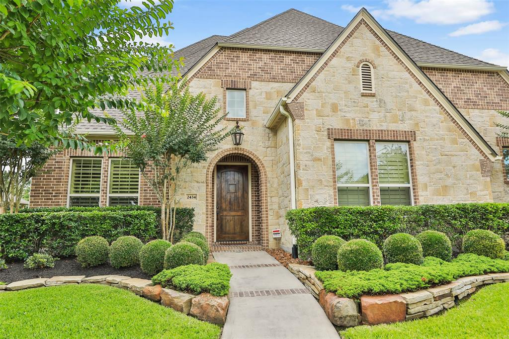 Impeccable custom HM on huge culdesac in gated community! Location, Location... Convenient to Exxon Mobile, The Woodlands, Grand Parkway, Beltway 8, Hardy Toll. Grand 2-story entrance & curved staircase sets the tone. 3 bedrooms up, Master and add'l bedroom down, w/ easy access to upstairs w/ 2 staircases... one near Master. Open concept living, kitchen, & breakfast area overlooking a sparkling pool/spa, covered outdoor kitchen, fireplace, and TV, as well as pristine lakes and walk paths. Kitchen features granite island, SS appliances, farmhouse style sink, commercial style gas cooktop w/ griddle, Pot Filler, Wine Cooler, Commercial Style built-in GE Monogram Refrigerator and walk-in pantry. The Master Suite features sitting area and 2 separate large His/Her Walk-In Closets. All secondary bedrooms also have lg Walk-In Closets for infinite storage. 3 attic access points; one of which is a floored walk-in space. Never run out of hot water w/ a tankless hot water heater. NEW ROOF 09/2020.