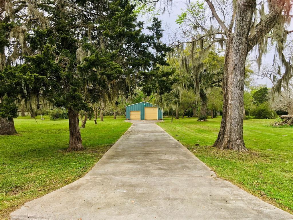 Barn is 28x36 on a total of 2.94 acres in the heart of Sargent!!!!  Beautiful wooded lots, with fruit, Pecan and Oak trees.  Three Stall covered  horse area and the barn has doors on each end!!  Would make a gorgeous homesite, with plenty of room to spread out.  Subdivision offers 3 Boat ramps, and is located 2 miles from Sargent Beach!  Great fishing in East Matagorda Bay and Gulf of Mexico access via Mitchel's Cut at the mouth of Caney Creek  Come check this out, and see what Sargent has to offer!!