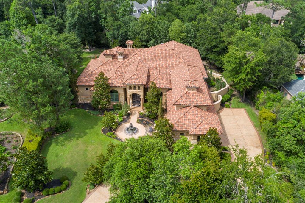 Have your own Italian Oasis in gated Carlton Woods with this stone + stucco Tuscan home on a large cul-de-sac lot. Get that modern open feel with 2-story custom ceilings & 2-story windows throughout most of the house.  The grand living room and the family room even have oversize butted glass picture windows with stunning garden & pool views. Custom kitchen w/spacious breakfast bar, professional Bosch/Thermador app. Primary suite is the ultimate getaway with his & her separate bathrooms, soaring ceilings, 2 story windows, a great view and custom finishes. Spacious secondary bedrooms, utility room complete with shower & door to side yard. Wine grotto features elaborate ceiling w/wrought iron gate. Oversized media room with nearby summer kitchen & bar. Backyard checks all the boxes; saltwater pool & spa, outdoor kitchen, wet bar, fireplace, plus second covered private patio, mosquito control system++. Full 3-car garage w/epoxy floors. The home lives as a one-story w/media & 4th bedroom up