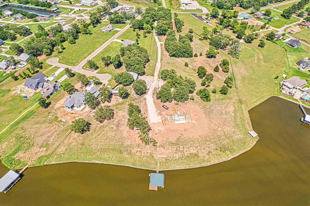 No restrictions, some best views in Lake Livingston.  Across the street from Marina.  Client is selling a 1.50 lot tract with barnhome for $500k, 140 feet water frontage.  Client also selling a 1.0 acre lot next door for $300k with 140ft of water frontage.  OR if you want both 2.77 acres, client will sell for 750k. Check out the live drone footage of property and lake.