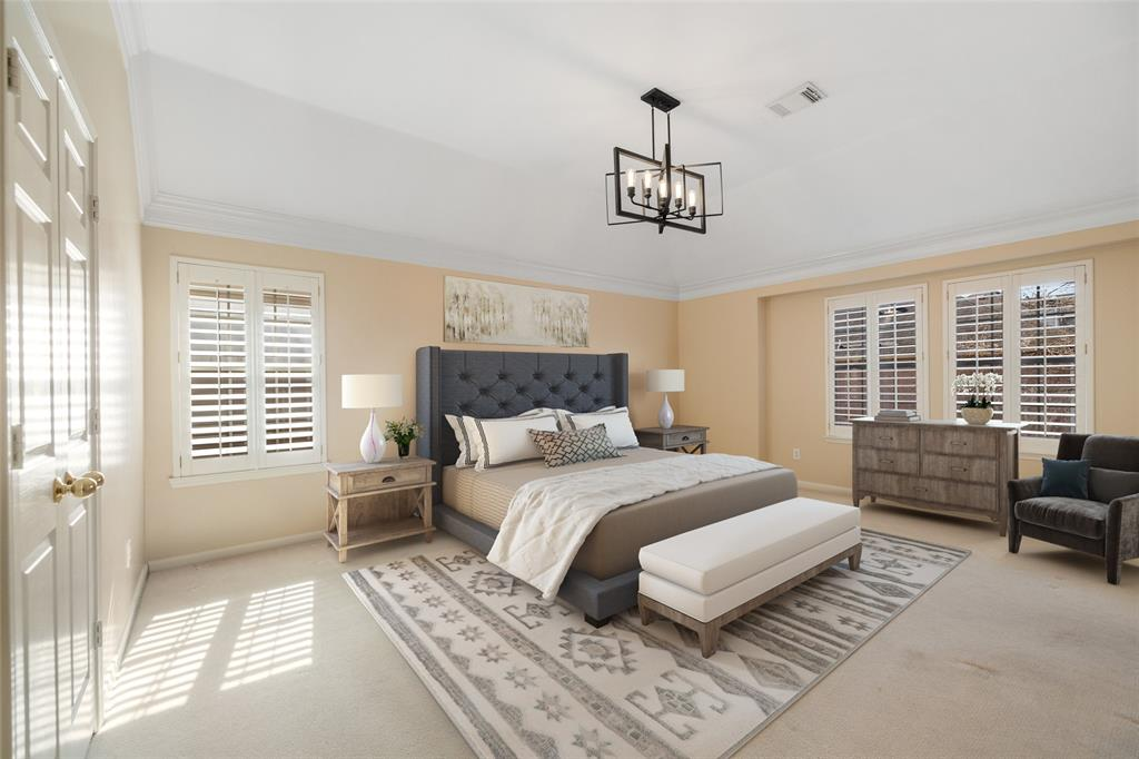 The spacious primary suite feature lots of natural light, plantation shutters and new carpet. This photo has been virtually staged.