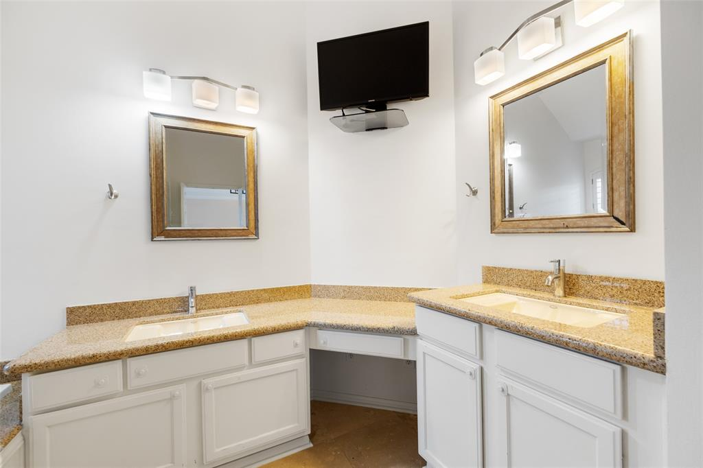 The primary bath features dual vanities and lots of storage.