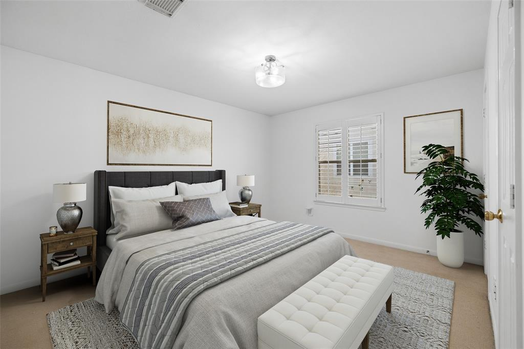 Bedroom # 3 features new interior paint, plantation shutters and new carpet. This photo has been virtually staged.