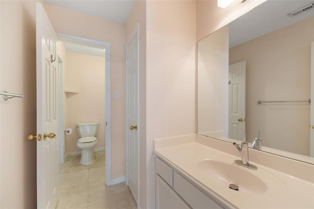 The Jack and Jill bathroom connects the two secondary bedrooms and functions well for families with kids.