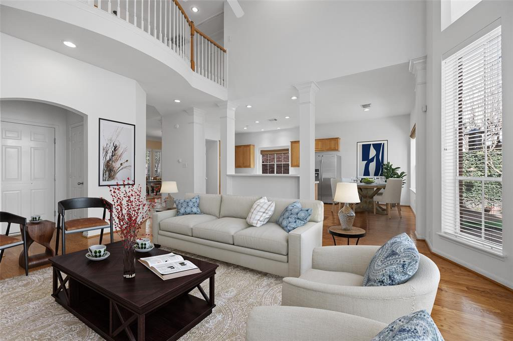 The living space opens to the kitchen and breakfast area which makes this floor plan perfect for family living and entertaining. This photo has been virtually staged.