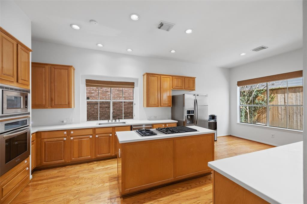 The kitchen features tons of storage options.