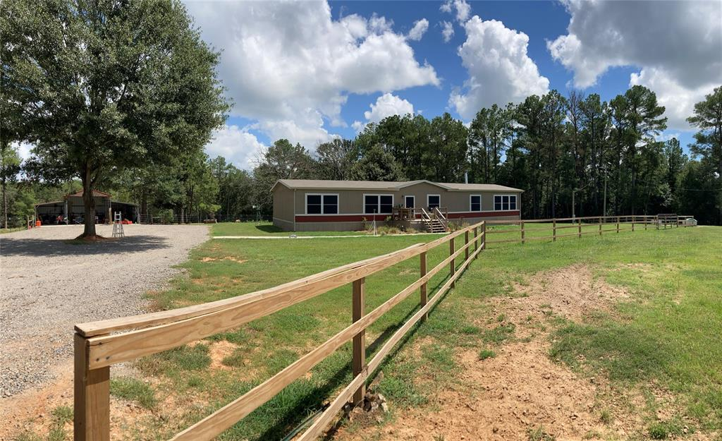 Check out this 4-bedroom, 2-bathroom home on 10.18 acres located on FM 811 just east of town. Property is a  mix of open pasture and scattered trees. It has a pond, a metal barn/shop, and an above-ground pool. The home is 2,340 sq ft with TWO living areas and a fireplace. The kitchen features a large island with plenty of storage space. The utility room/mudroom has space for a refrigerator and has a sink. The primary bedroom has a large walk-in closet, a soaking tub, and a shower.