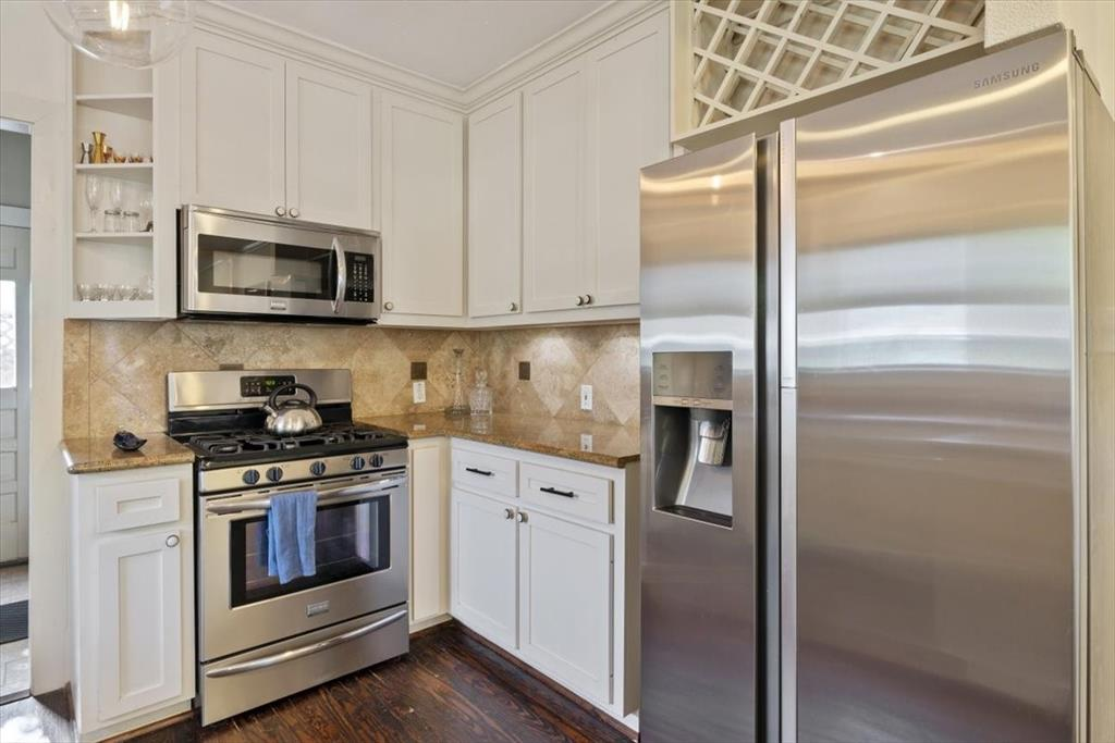 Stainless appliances. Gas stove and range.
