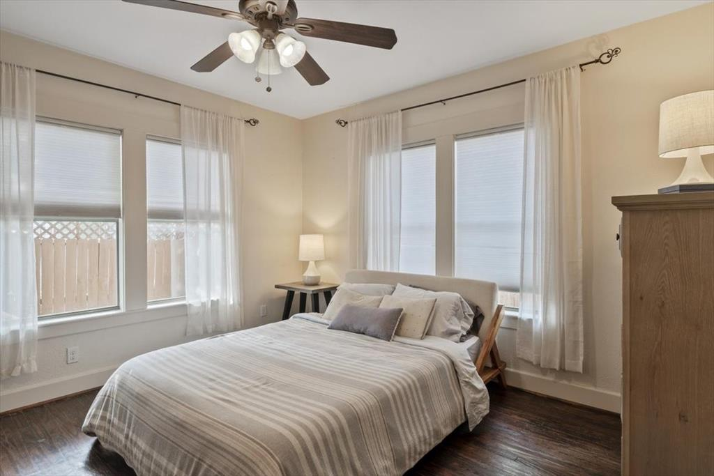 Ceiling fans and windows make the primary bedroom comfortable and bright.