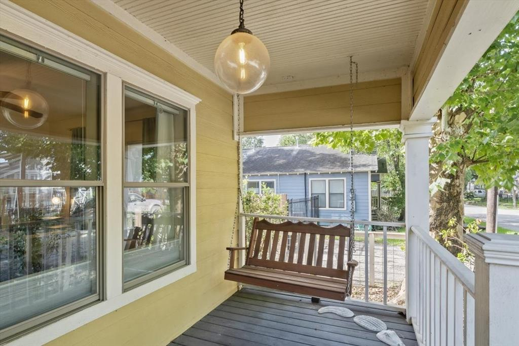 Ideal front porch allows you to relax and look out at the tree lined street. Rates high on the