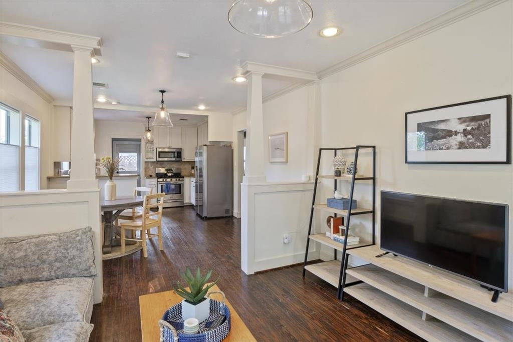 The bungalow features rustic wood floors throughout.