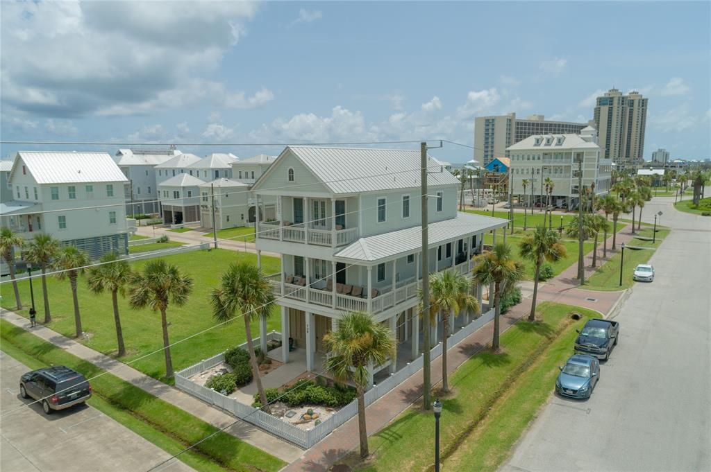 This luxurious beach house is located in Galveston's sought after Beachtown. The Home features three stories with four bedrooms, three and a half bathrooms. Kitchen has elegant Custom beadboard cabinets, carrara marble countertops and stainless steel appliances. Elevator is accessible on every level. Watch the beautiful sunrise and enjoy the gulf breeze from one of the several balconies. Within walking distance to the beach, community pool and the Porch Cafe. Vacation rentals allowed.