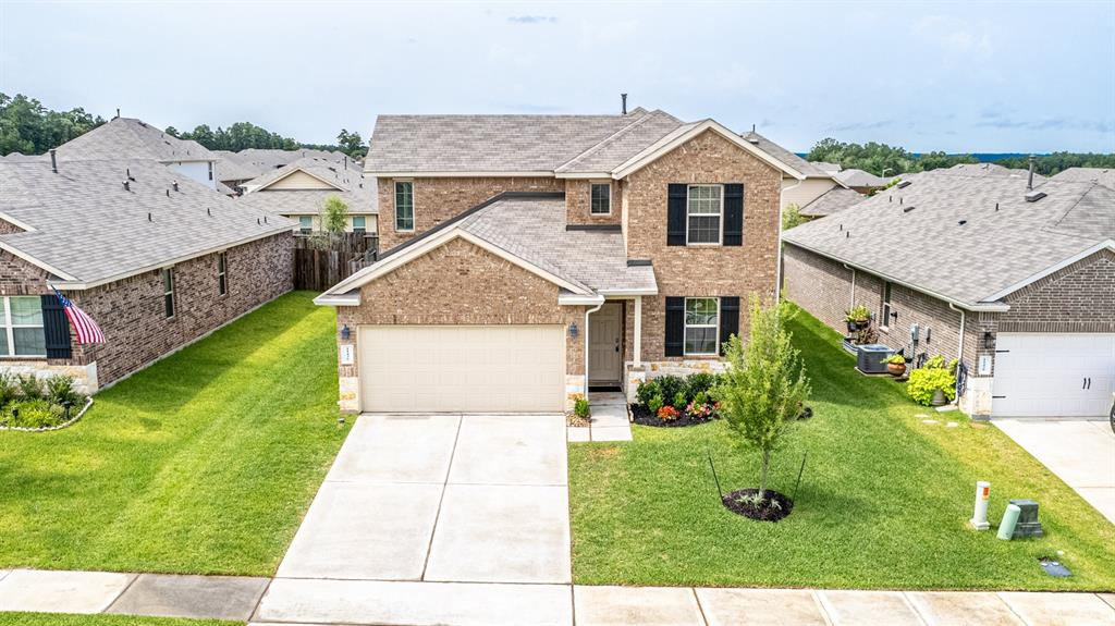 Come get this 'good as new' home with LAKE ACCESS available! There is a boat launch in the community for Water Crest homeowners in addition to a beautiful pool area overlooking the Lake, clubhouse, fishing ponds, and more! The location is great with proximity to Lake Conroe, but also with quick access to I-45 for commuting to Conroe, The Woodlands, IAH, and Houston. You are away from it all, but near it all. The home is in great shape with plenty of space. You'll love the open floor plan where dining, cooking, and living all converge in one space. It's great for entertaining and family gatherings. The primary bedroom is downstairs with another office space as well. This home has a tankless water heater, gutters, covered back patio, and a fridge and washer/dryer that convey with the home just to name a few perks! Upstairs is a large game room with three additional bedrooms and a bathroom. Come get this wonderful opportunity to own a recently built, updated home in a great community!
