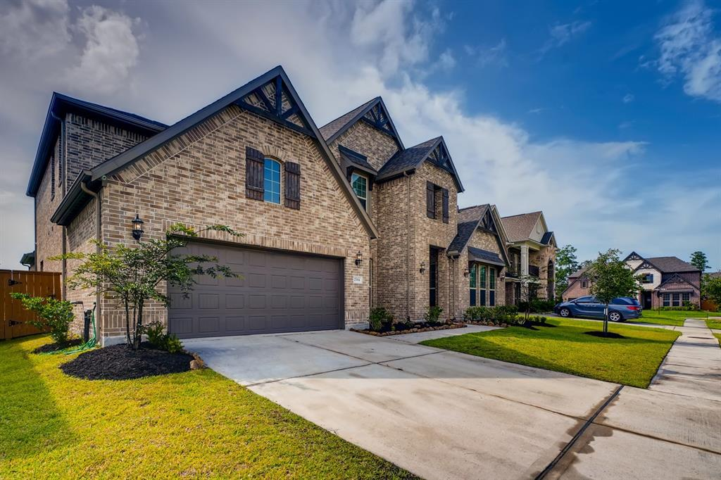 Built by Taylor Morrison - The Calypso floor plan offers enough square footage to offer something special for everyone in the house. Entertain in the The Chef's kitchen with Butler' Pantry  gourmet kitchen with two large double islands and great room with high ceiling. Two custom wall built-ins in the family room. Enjoy movie nights in the dedicated media room. Have a laugh in the game room. This home also offers a Multi Gen space with a secondary bedroom down and a junior suite upstairs. Jack-n-Jill Bedrooms upstairs. Features: Blinds- all windows,  Energy efficient home, Tankless Water Heater, 9 Video Camera System, Surround Sound , Two 10'x10' storage building in backyard,  3 car tandem garage. Cool off on the spacious covered patio.   Whatever you're looking to do, you'll find space to do it.*Only minutes from The Hardy Toll Road, I-45, I-59, 99 & The Woodlands Town Center -there isn't anywhere more convenient to live.