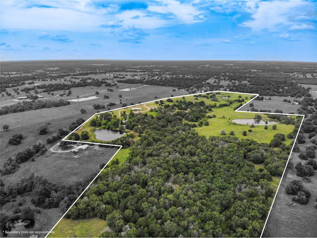 Just under 30 minutes to Brenham and only 15 minutes to Giddings, this 60 acres abundant with wildlife provides the best of both worlds. Boasting three beautiful ponds, two of which are larger than an acre and stocked, plus a partially wooded and rolling landscape. This is the land you have been looking for to escape to the country and enjoy the privacy with modern conveniences close by! Mobile homes on property will be removed prior to closing.
