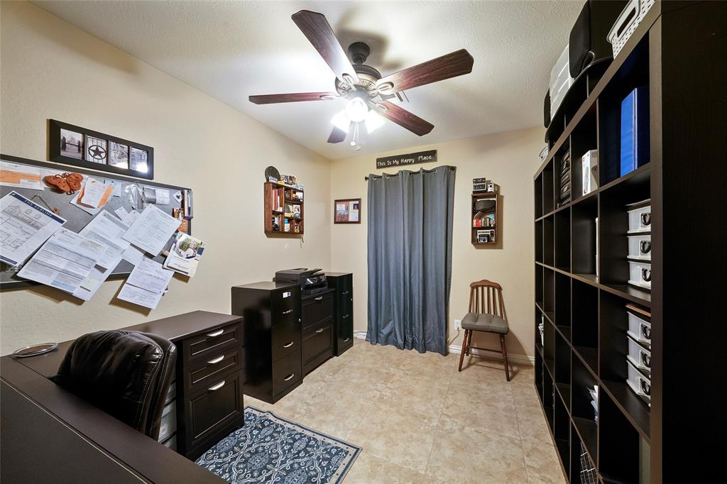 This study is located just off the kitchen and offers a nice space for at home work or crafts.