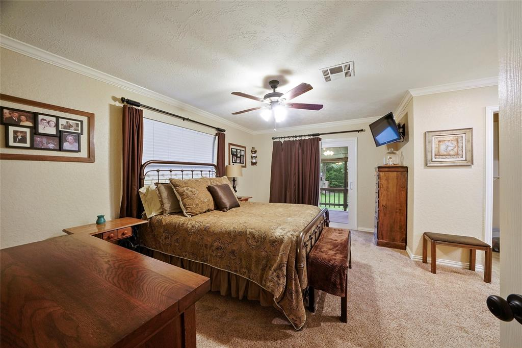 The master bedroom also includes crown molding and access to the back patio.