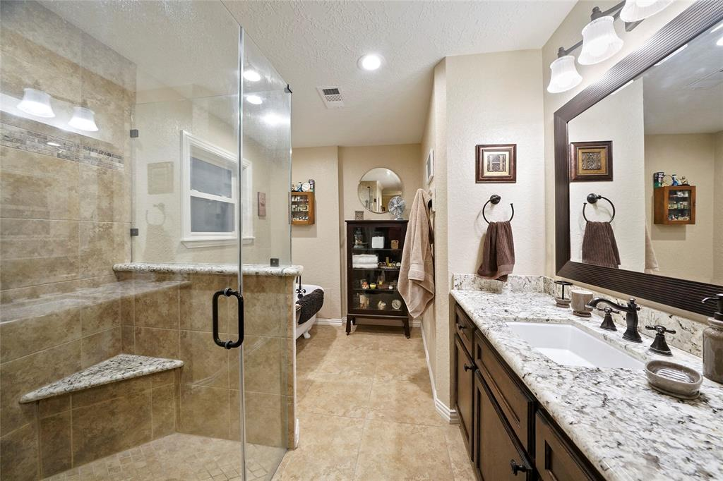 Updated in 2013, the master bathroom has a separate shower, large vanity, and a clawfoot tub.
