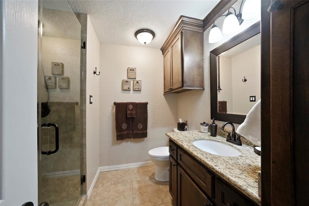 The guest bathroom has also been updated and includes a stand up shower and new cabinetry.