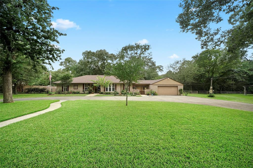 Out front, you will find a ton of guest parking along the circle driveway. The home has been beautifully landscaped around the home. Two car garage includes a new garage door opener in 2020.