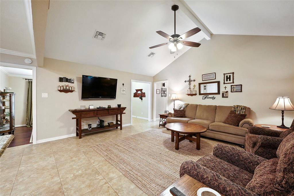 The large family room includes vaulted ceilings and tons of space.