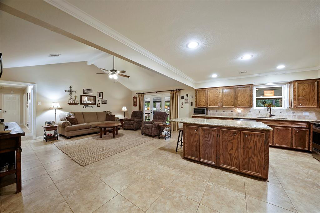 The kitchen is open to the living room, which makes this space a great space to entertain and visit with family.