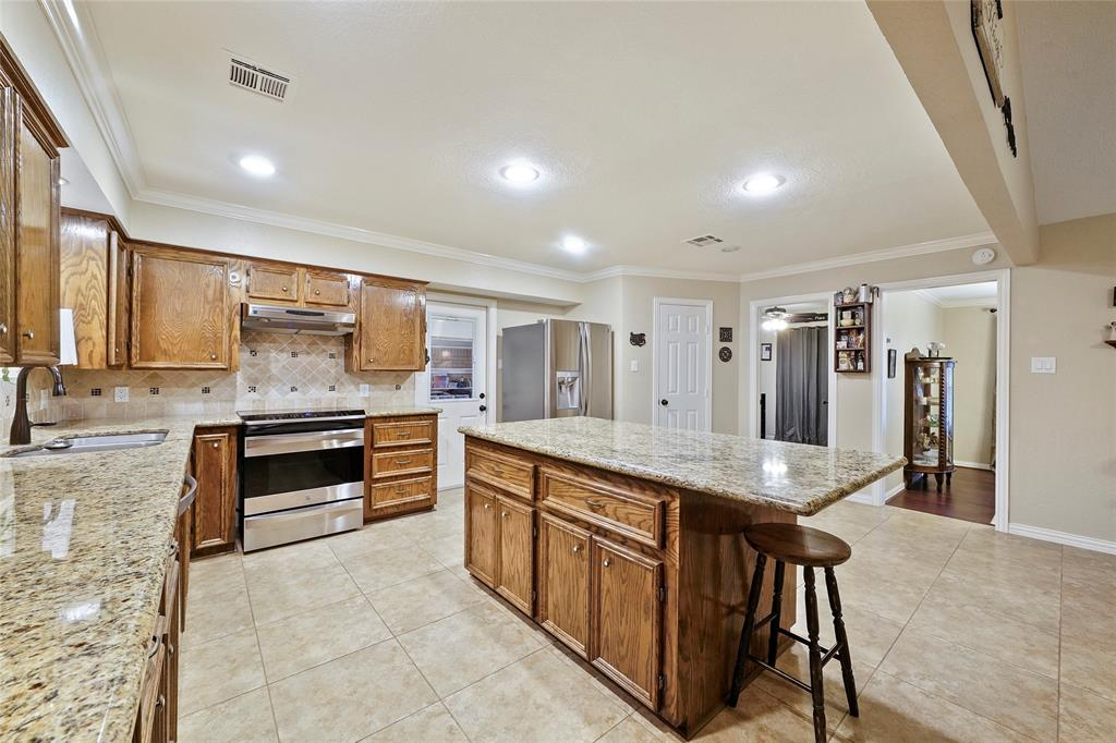 The kitchen was updated in 2013 and included granite countertops, stainless steel appliances, and a huge pantry.