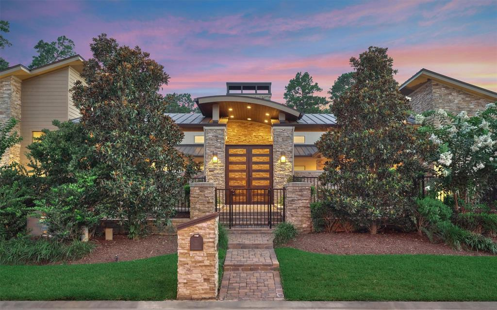 Hard to find modern masterpiece rests on over half an acre of wooded privacy mere steps from Lake Conroe's tranquil shores. Step behind the gated front yard and into the secluded, travertine-tiled courtyard to be greeted by the sparkling pool and spa. Inside you will find soaring ceilings, decor lighting, electric shades, and wood floors throughout. The sleek chef's kitchen features Thermador appliances, built-in coffee-bar, and quartz counters. Th  open plan dining and family rooms highlight a stunning floor-to-ceiling fireplace—perfect for entertaining. The primary suite is complete with a custom mirrored wall, a spacious bathroom straight out of a 5-star hotel, and an oversized closet with built-ins. There is a secondary bedroom and a study that can be used as a 4th bedroom, as well as a half bath with a unique stone accent wall. A private casita is accessible through the courtyard and garage court, and the lush backyard is great for kids and pets. Enjoy all that Lake Conroe offers!