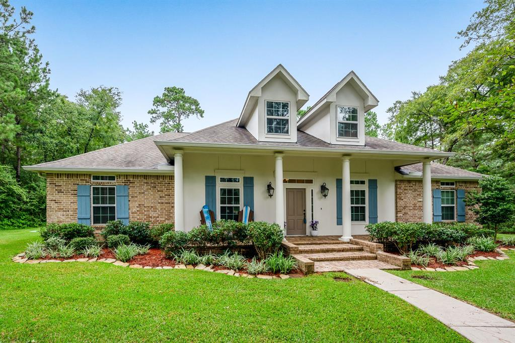 """Beautiful 1-story on 2 acres in highly sought after Estates of Clear Creek. This 4 bedroom, 2.5 bathroom home is surrounded by trees providing plenty of privacy. Amazing kitchen features gorgeous granite countertops, tile backsplash, stainless steel appliances, gas cooktop, large corner panty and breakfast bar. Built-in storage bench and custom table in the breakfast room. Private study offers laminate flooring and French doors. Quartz countertops in all bathrooms. Master suite is complete with his/her vanities, whirlpool tub, separate oversized shower with bench and 2 walk-in closets. Versatile """"flex"""" room is perfect as a home gym, extra storage, etc. Tray ceilings, crown molding, cordless window blinds, whole house generator. Covered back patio boasts an outdoor fireplace overlooking the massive backyard with a custom playset built into the trees.  Zoned to Magnolia ISD.  You do not want to miss this incredible home!  Make your showing appointment today!"""