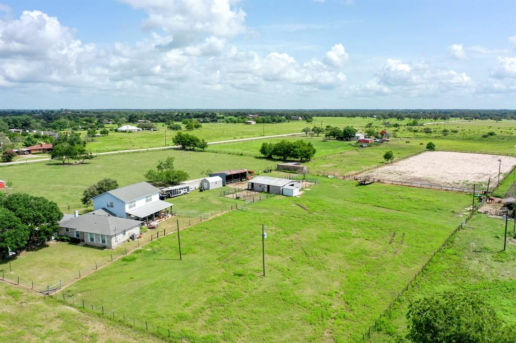 Excellent location of this beautiful county home on 8.4 acres located in Wickson Valley and set up nicely for hobby farmers, livestock show families, or rodeo and equine enthusiasts of all types. The home features 3733 sf, 3 beds, 3 baths, with a massive primary suite and office/game room, a private safe room, site built oak cabinets, Enercon vinyl replacement windows, and an oversized cedar framed outdoor covered porch to wind down. The entry drive is lined with live oak trees, planted with acorns from Texas A&M campus. The land is fenced and cross fenced with a front, middle, and back pastures/traps and features a 5 stall horse barn with cement center aisle, wash stall and feed room. Also on the property is an impressive 150 x 300ft riding arena and a 24x36ft 3 sided hay/equipment barn. Shipping container and appliances are included with the property!