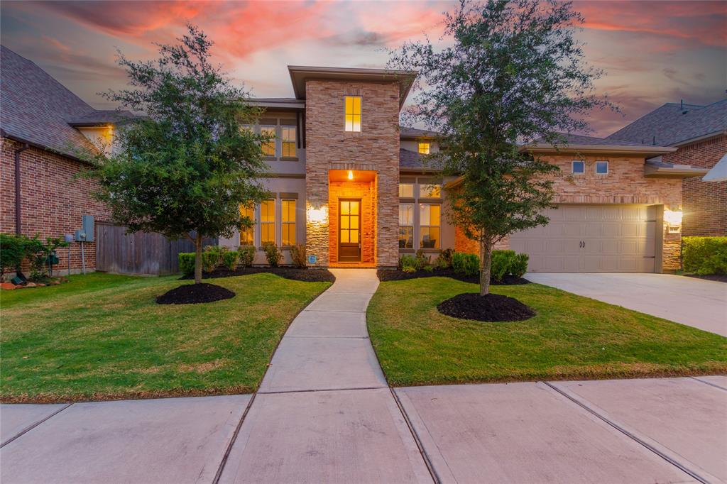 Welcome home to 2139 Acadian Way located in Jordan Ranch and zoned to Lamar Consolidated ISD. This gorgeous J. Patrick Home features 4 bedrooms, 3 full baths, and 1 half bath. Work from home in the private study. The chef's kitchen features dark stained cabinetry with light countertops, SS appliances, and room for bar seating. The family room includes a fireplace with mantel, tile flooring, and large windows allowing the natural light to shine through. End your days in the master suite. The ensuite includes a large walk-in shower with seating bench, separate garden tub, double sinks and walk-in closet. This floorplan also includes a downstairs guest bedroom. Come upstairs where you will find the game room and media room. Don't forget to step out back for a view of the covered patio and backyard. You don't want to miss all this home has to offer! Check out the 3D tour & schedule your showing today!