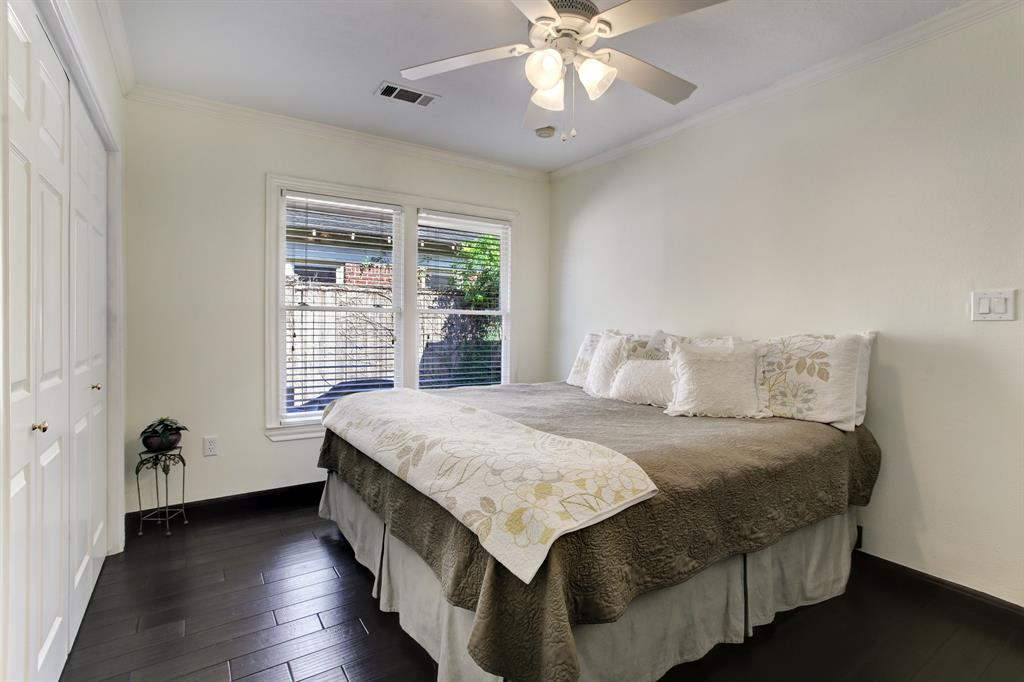 The third bedroom overlooks the side patio and has nearly a wall full of closet space.  This is a king bed with room to spare for night stands.
