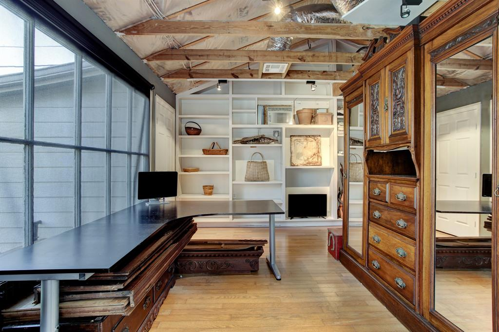 The air conditioned converted garage is such a fabulous extra space for an office, artist's studio, or exercise room.